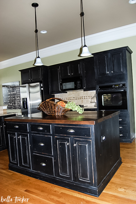 black distressed painted kitchen cabinet finish by Bella Tucker Decorative Finishes