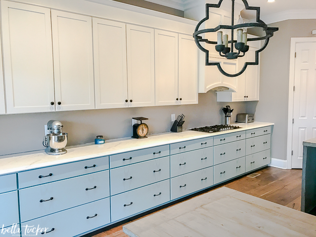 Farmhouse style kitchen with two color blue and white painted cabinets.