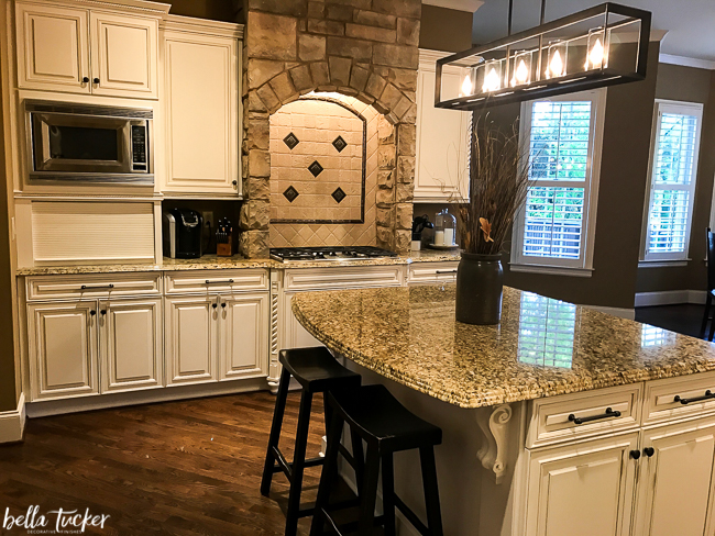 AFTER- updated Tuscan kitchen with painted cabinets