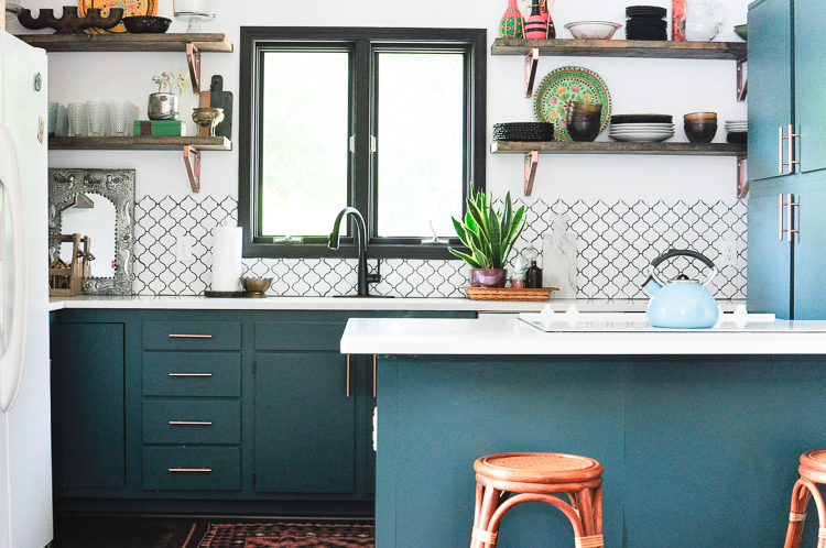 Erin Sparks in her updated kitchen with Sherwin Williams 0064 Blue Peacock Cabinets- photo by Samantha Nelson Photography