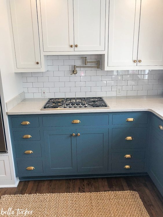 Blue lowers and white upper cabinets.
